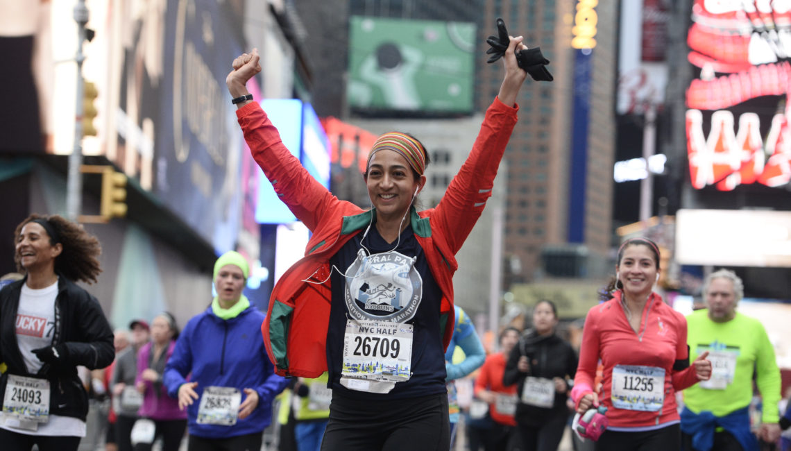NYC Half 2015  Times Sq  Runners, Kids, spectators, signage.